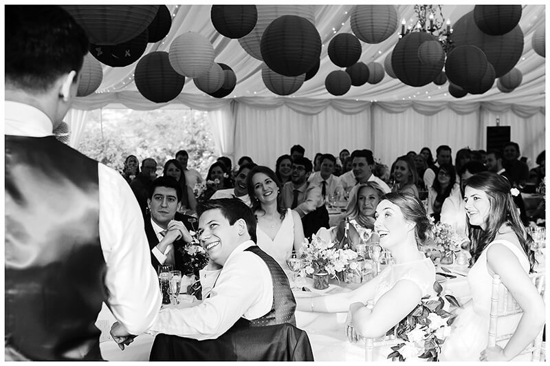 bride groom laugh during best mans speech