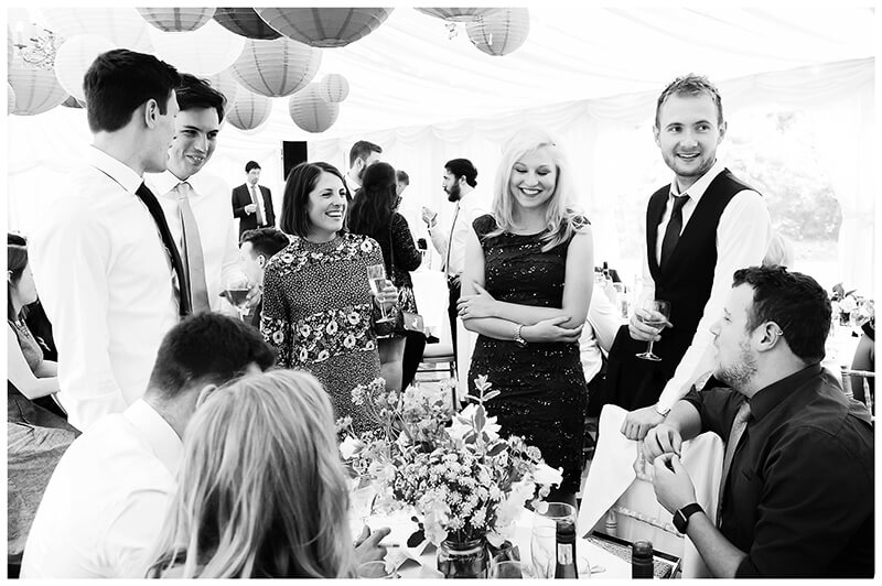 Wedding guests all standing round table