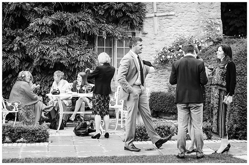 Wedding guests standing around in the gardens of friars Court