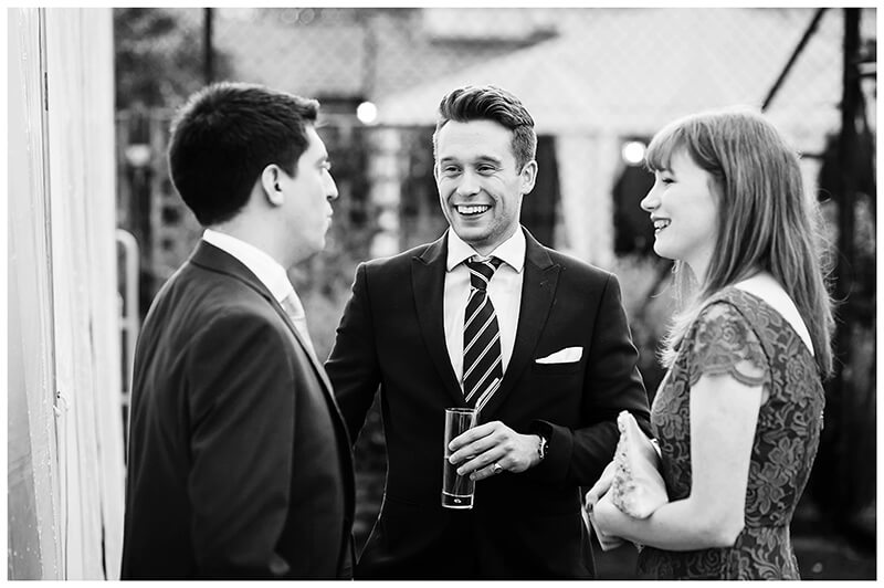 wedding guests in conversation