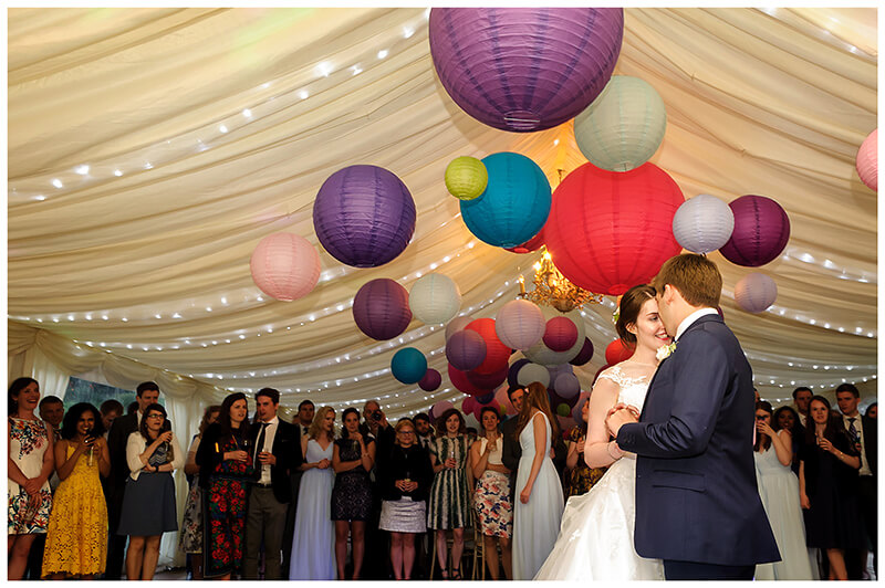 friars Court Wedding first dance in marquee under paper lanterns