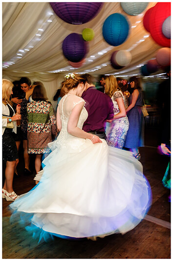 bride swirling dress on the dance floor