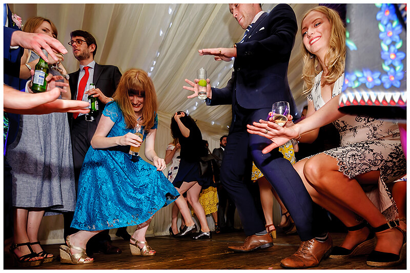 Wedding guest getting low on the dance floor