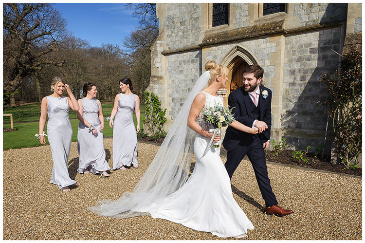Royal Chapel Windsor Great Park joyous bride groom followed by bridesmaids