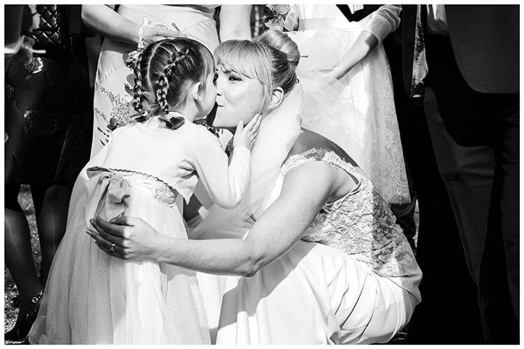 Royal Chapel Windsor Great Park bride kisses flower girl
