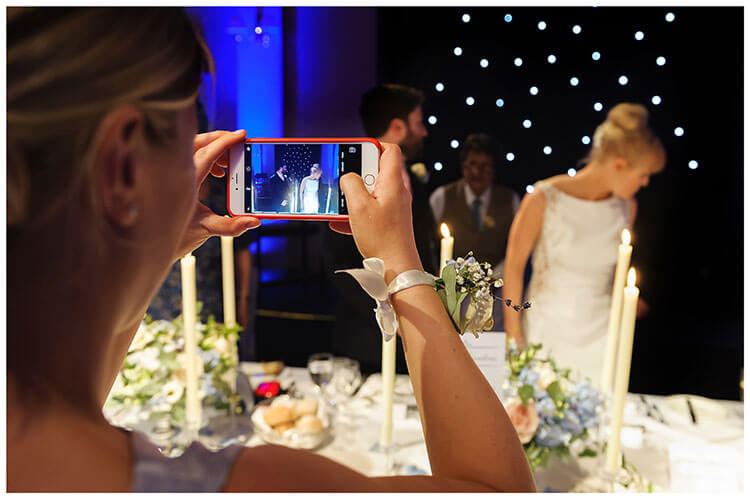 Wentworth Club Surrey photo on phone as bride groom arrive at table