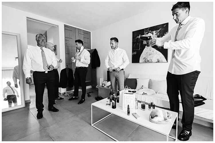 Groom and his grooms men getting ready Greek Island destination wedding