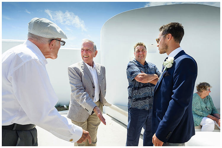 Groom talking to guests at wedding in Mykonos