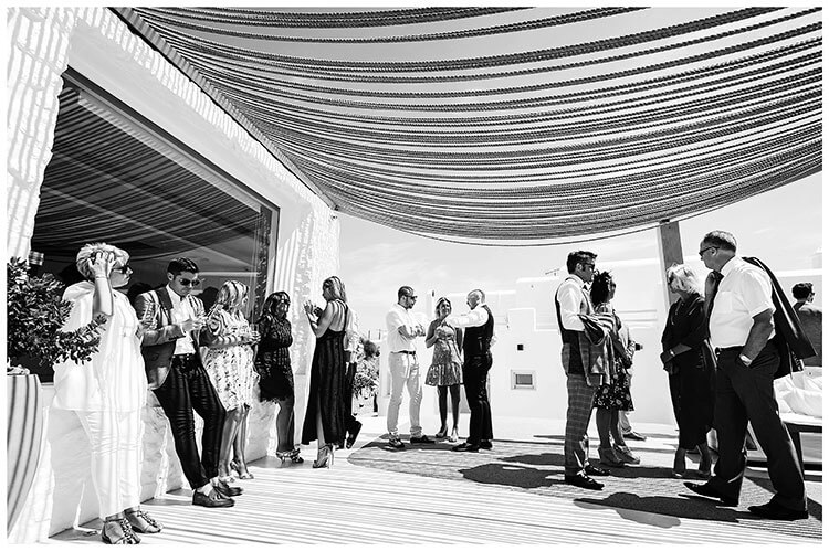 Guests waiting under rope canopy for Mykonos destination wedding