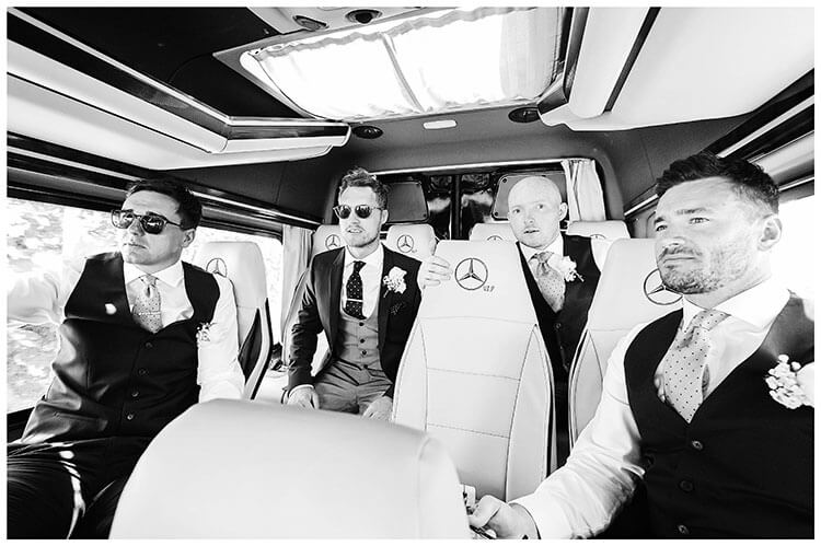 Groom and ushers in transport to destination wedding in Mykonos