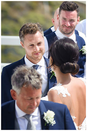 "Groom gazing at his Bride as she arrives at ""alter"" Mykonos destination wedding"