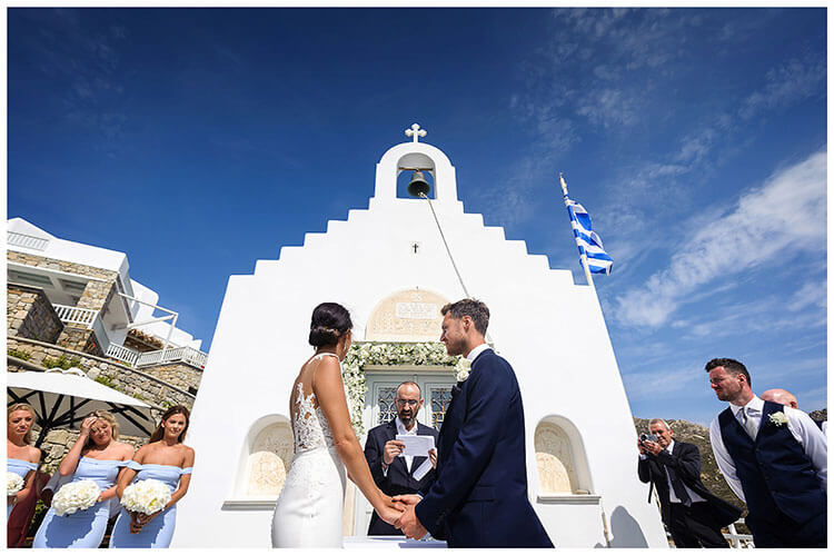 Bride & Groom holding hands during wedding ceremony in Mykonos