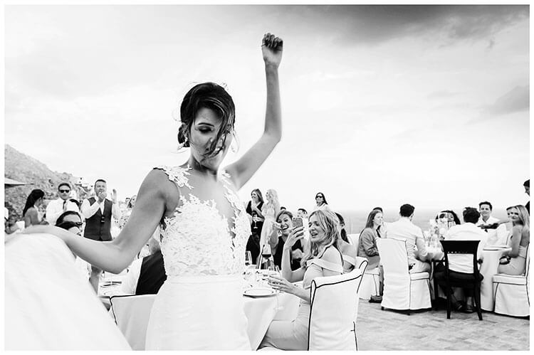 destination wedding in Mykonos happy bride dancing round tables during reception
