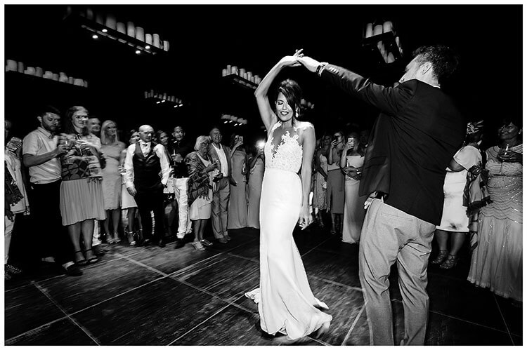 Bride & Groom first dance surrounded by guests during destination wedding at Royal Myconian Resort Hotel Mykonos