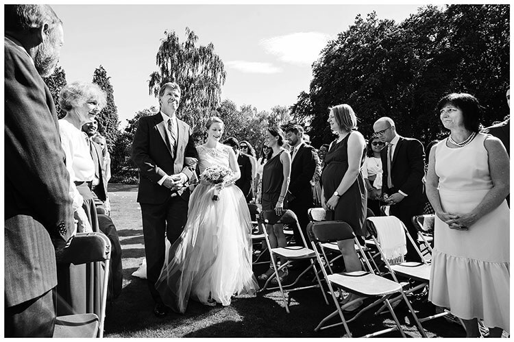 Best Wedding Photography of 2017 bride arrives on arm of emotional father
