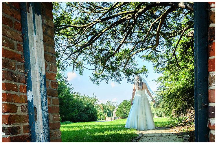 Best Wedding Photography of 2017 bride walking away holding bouquet