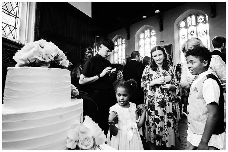 Best Wedding Photography of 2017 guests admiring the wedding cake