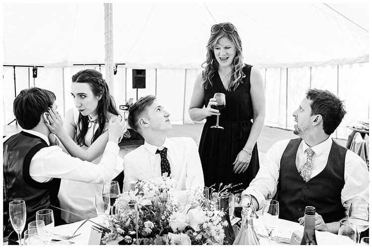 Best Wedding Photography of 2017 bride and guests around table