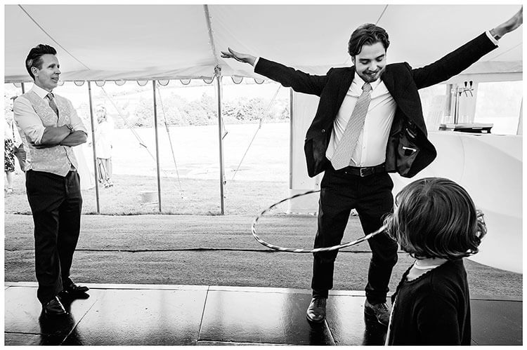 Best Wedding Photography of 2017 failing at hoola Hooping as child watches