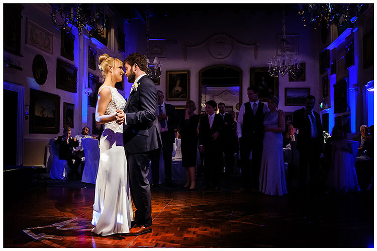 Best Wedding Photography of 2017 bride groom embrace during first dance watched by guests at wentworth golf club