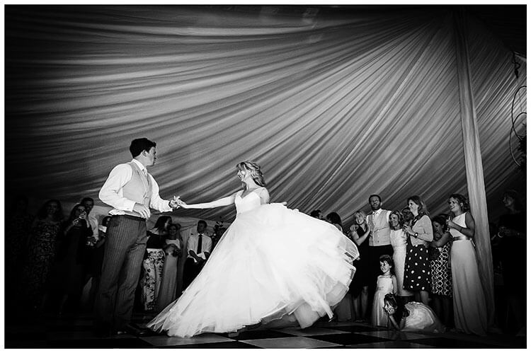 Best Wedding Photography of 2017 Bride groom first dance in marquee watched by family and friends