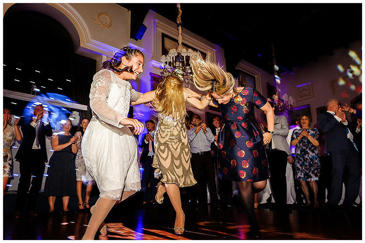 Best Wedding Photography of 2017 ladies dancing shaking their heads their hair waving all about
