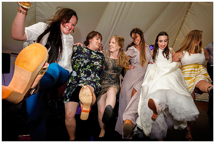 Best Wedding Photography of 2017 ladies doing the can-can with bride