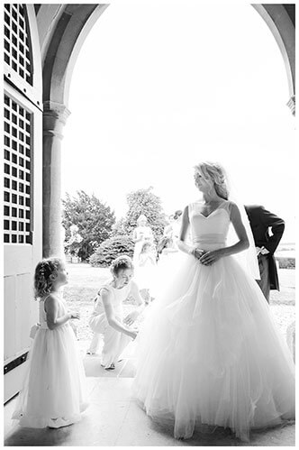 village wedding in Crishall Cambridgeshire Bride and flowergirl looking at each othert