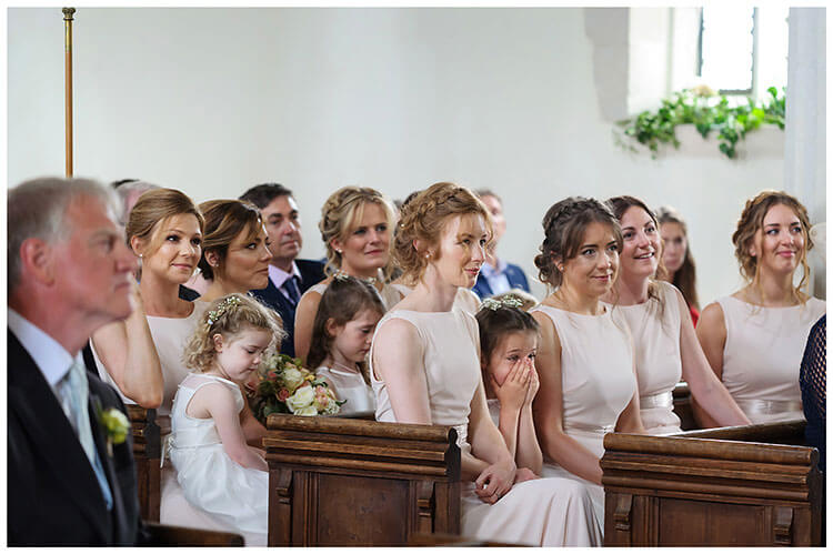 Village wedding at Crishall Church Bridesmaids in pews