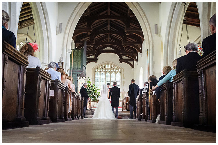 Village wedding at Crishall Church Cambridgeshire Bride Groom at alter