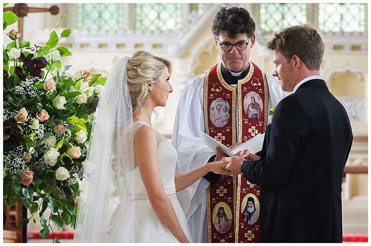 exchanging rings during Crishall Cambridgeshire Village wedding