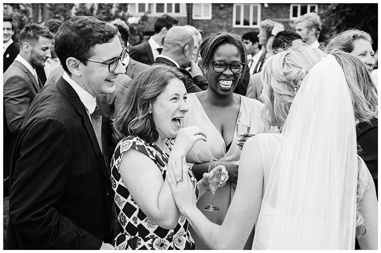 happy guests greet Bride at Crishall Cambridgeshire Village wedding