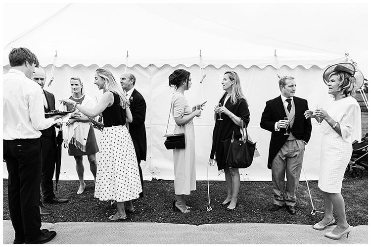 guests in front of marquee at Crishall Cambridgeshire Village wedding
