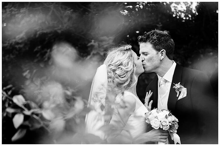 Bride Groom kiss at Crishall Cambridgeshire Village wedding
