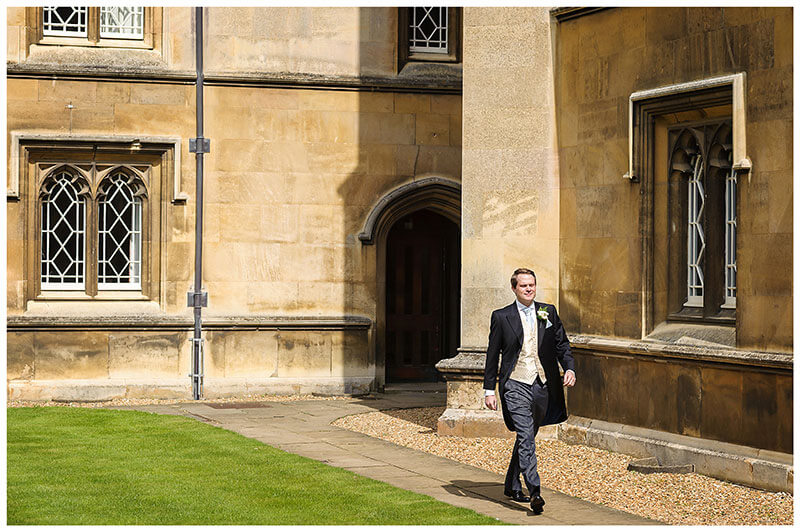 Groom leaving St Johns College Cambridge for the wedding ceremony