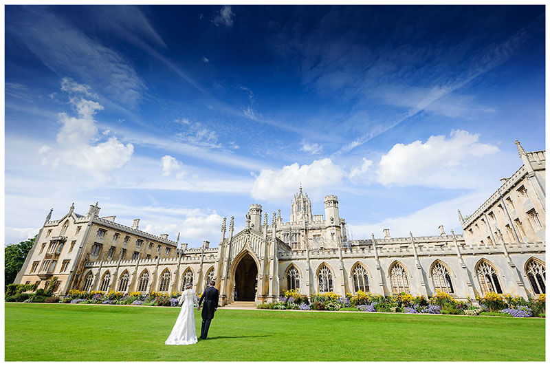 bride groom walking towards St Johns College Cambridge
