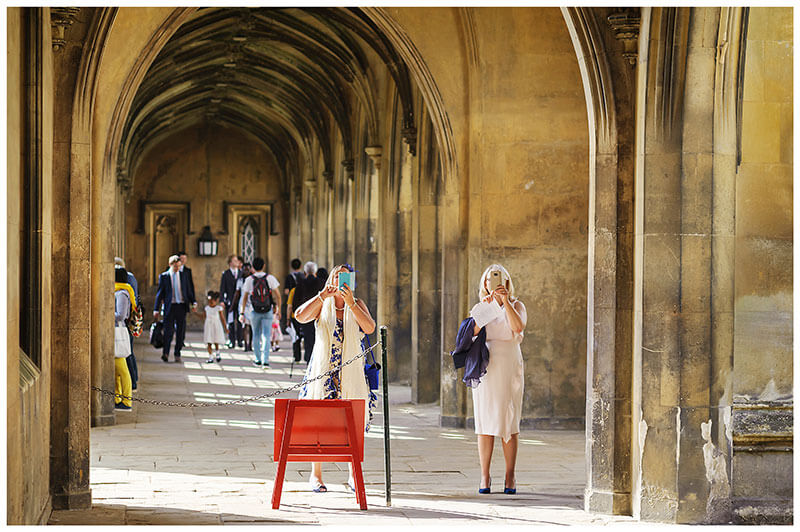 Wedding guests take phone photos of St Johns College Cambridge