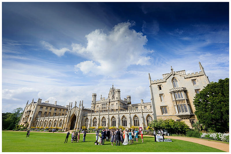 Wedding party on lawns with St Johns College Cambridge in background