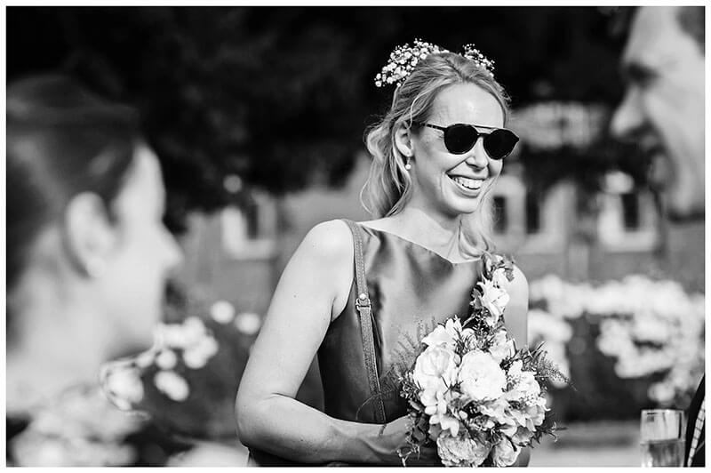 Bridesmaid in sunglasses smiling
