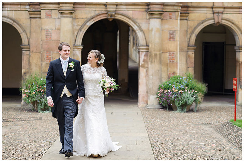 bride groom walking through St Johns College Cambridge third court