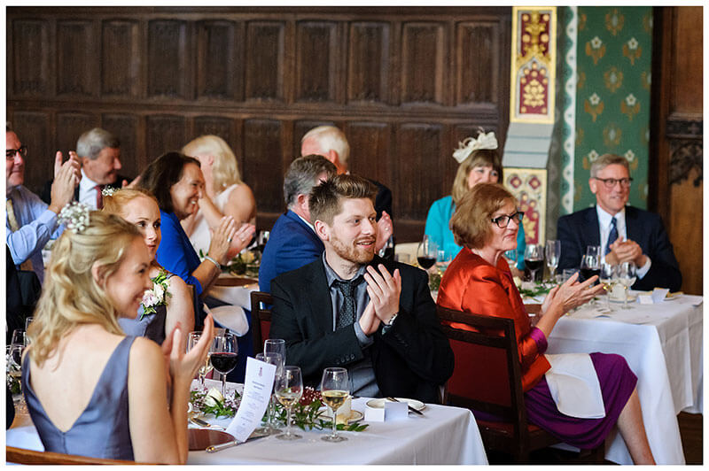 wedding guests applauding speeches during St Johns College wedding reception