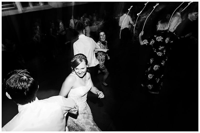 smiling bride dancing with groom during wedding reception