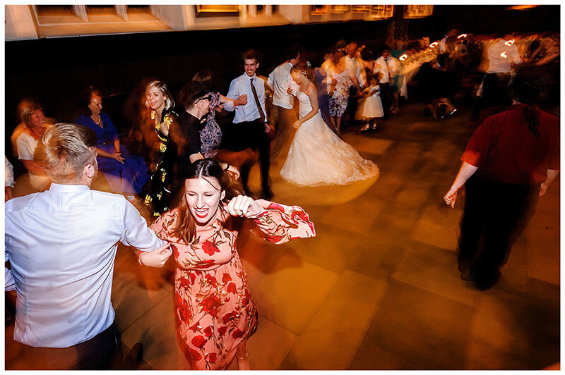 girl in red flowery dress enjoying kayleigh dancing during wedding reception