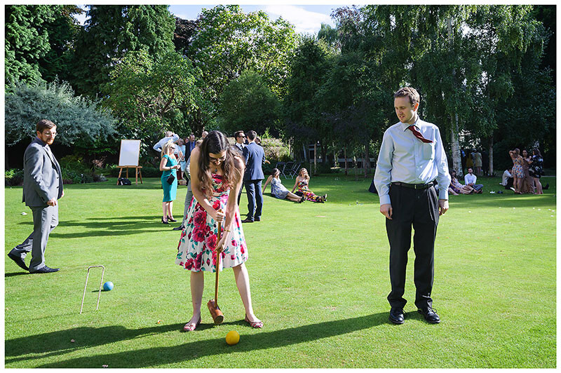 Playing croquette at Queens college wedding blessing