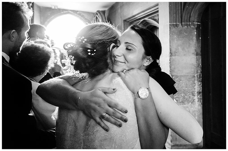 Big hug for bride Queens college wedding blessing