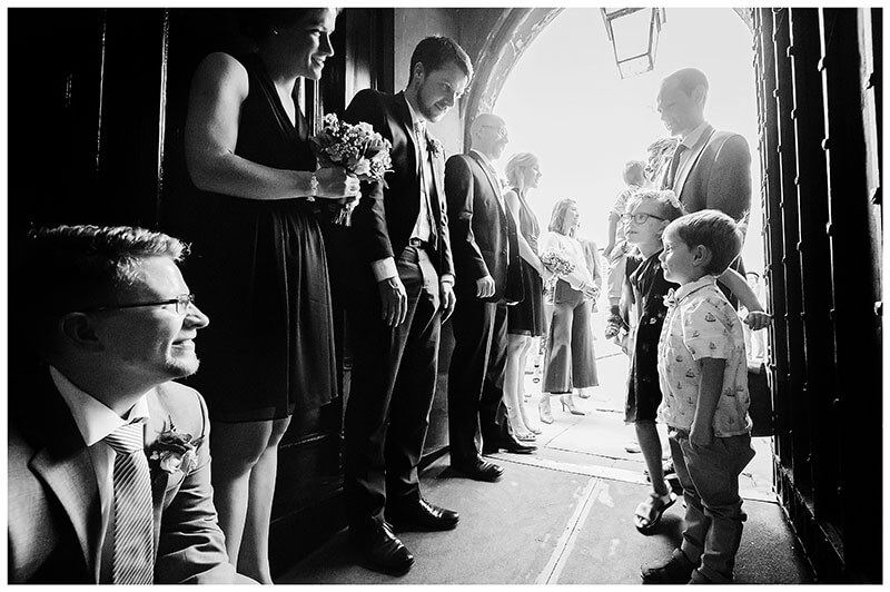 Children welcomed by ushers and bridesmaids during recieving line at Queens college wedding blessing
