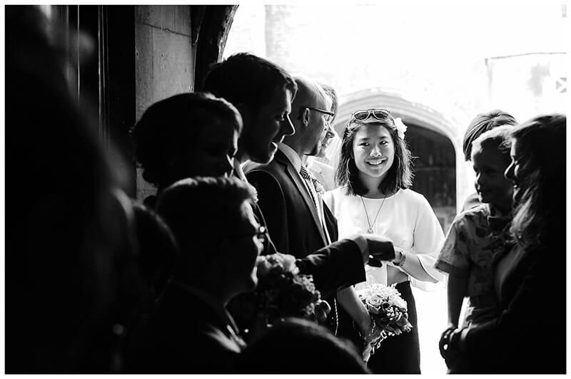 Girl smiling at end of recieving line Queens college wedding blessing