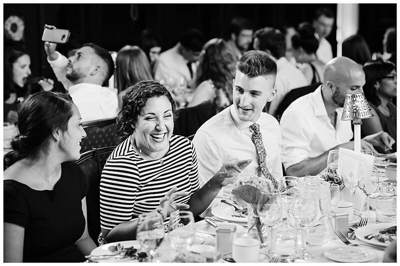 laughter during dinner at Old Hall Queens college wedding blessing