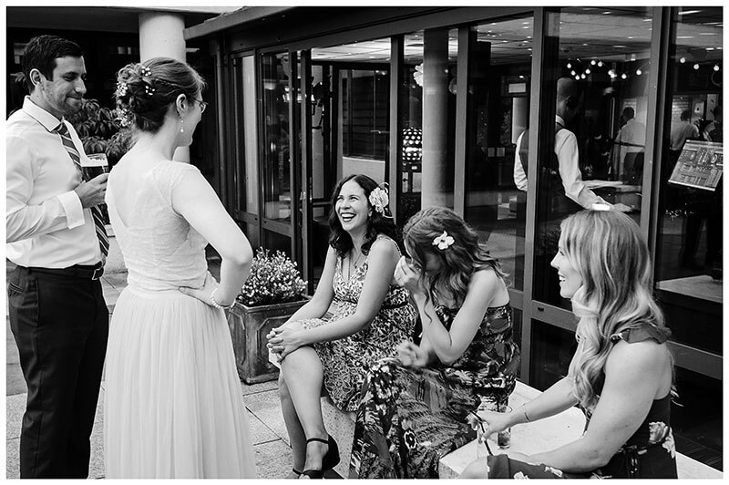 Laughing with Bride at Queens college wedding blessing evening party