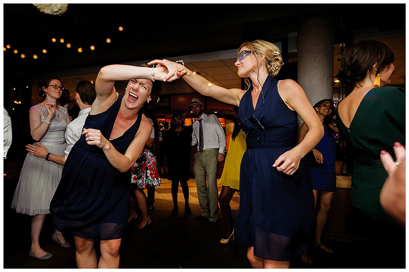 Laughing bridesmaids on the dance floor at Queens college wedding blessing